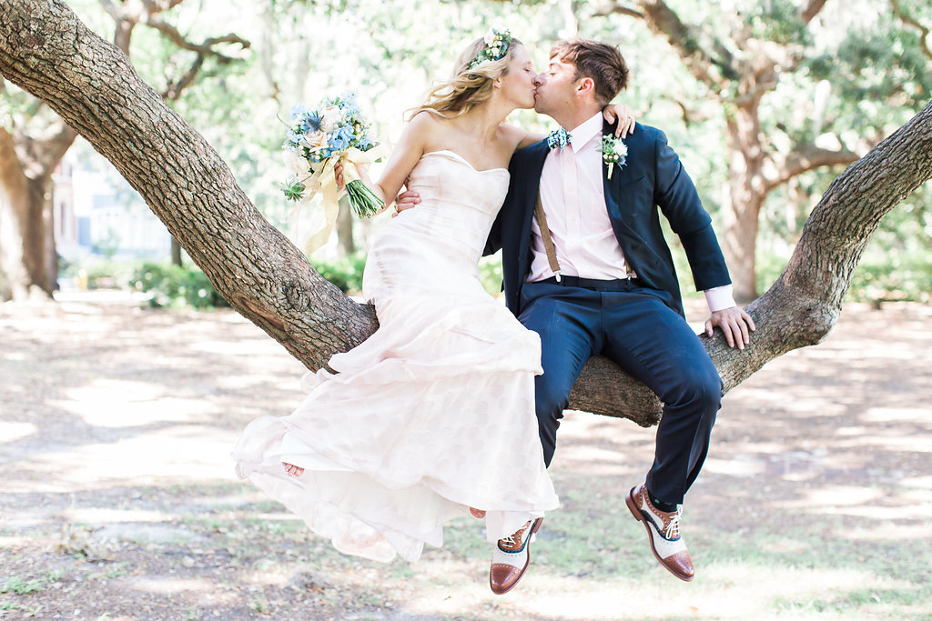 newlywed couple kissing in tree