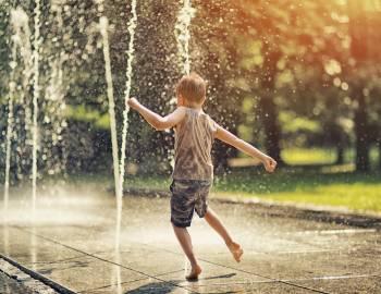 Child splashing at Ellis Square
